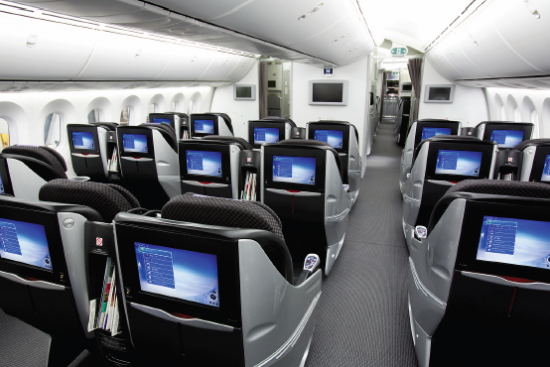 a view of the reclining, multimedia seats in JAL's Business Class on the new Boeing 787 Dreamliner.