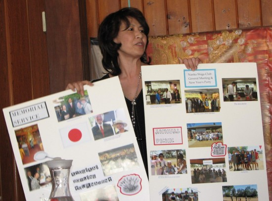 Jolene Sekijima shows photos of the club's activities over the past year.