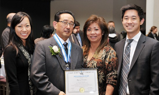 Silver Beaver awardee Michael Obi (second from left) with (from left) daughter Michelle, wife Junko and son Chris. Obi has volunteered with Nishi Hongwanji Buddhist Temple's Troop 738 for more than 20 years.