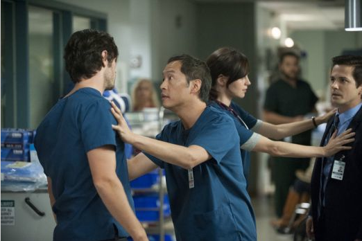 "Ken Leung (center) in a scene from ""The Night Shift."""
