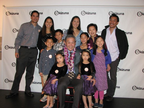 Alan Nishio (front, center) with grandchildren Emi and Kira (front row), Ty, Evan, Alexa and Sara (second row). Back row, from left: Son-in-law Gregory Lockwood, daughter Mia Nishio, daughter Angela Nishio Ty, wife Yvonne Nishio and son-in-law Jonathan Ty.