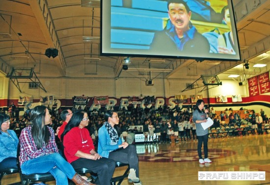Coach Camryn Ito speaks during a ceremony at Troy High in Fullerton, to retire the coaching shirt of the late Steve Yano.