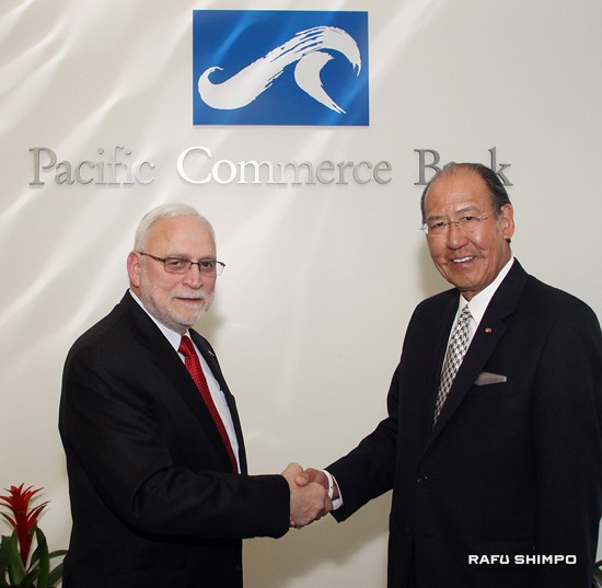 Thomas Iino (right) and Frank Mercardante pose in front of Pacific Commerce Bank in Little Tokyo on Feb. 24. (MARIO G. REYES/Rafu Shimpo)