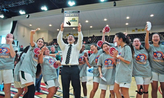 South head coach Bobby Imamura lets out a yell as he hoists the championship plaque.