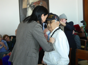 Consul General Pauline Carmona presents the Legion of Honor to 442nd veteran Masao Kadota.