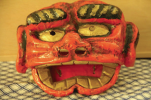 A mask made of carved daikon and paper mache, and painted by Enjiro Kodani at Tule Lake. (Courtesy of Bando Mitsusa)