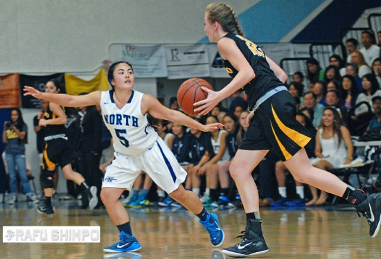 North High's Kylie Oshiro guards Brooke Salas of El Dorado High on March 18. (MIKEY HIRANO CULROSS/Rafu Shimpo)