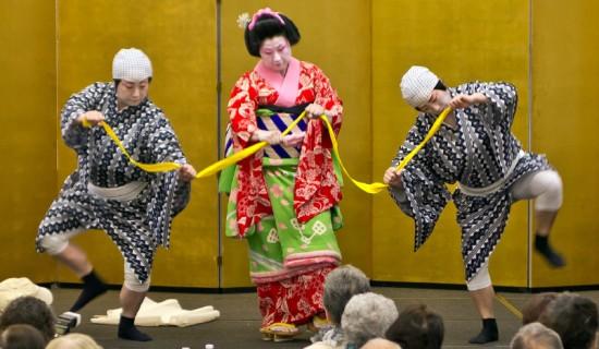 """Fujima Kansuyu (Susie Ito) portrays Okane in the dance """"Omi no Okane"""" at the Gardena Pioneer Project New Year's Luncheon. She is Fujima Kansubai (Jeanne Ideno) and Fujima Kansuou (Joanne Yamahata) who portray fishermen."""
