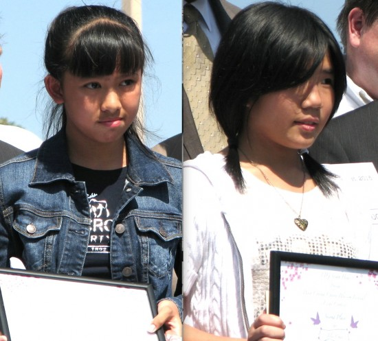Below: Essay contest winners Sarah Lam (first) and Jolie Chan (second).