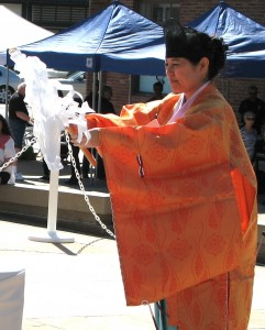 Izumi Hasegawa, senior priest of Shusse Inari Jinja, performs a Shinto ceremony.
