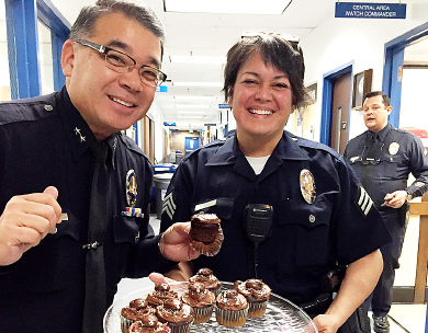 Deputy Chief Terry Hara with a policewoman who brought cupcakes.