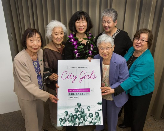 "Valerie Matsumoto with members of the Atomettes, one of the Nisei clubs she wrote about in ""City Girls."" From left: Sadie Hifumi, Aiko Herzig-Yoshinaga, Matsumoto, Vicki Mittwer Littman, Rose Honda (foreground), and Kathi Yamazaki. (Courtesy of UCLA Media Relations)"