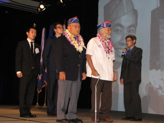 Essay contest winners and Nisei veterans shared the stage at last year's Evening of Aloha. (J.K. YAMAMOTO/Rafu Shimpo)