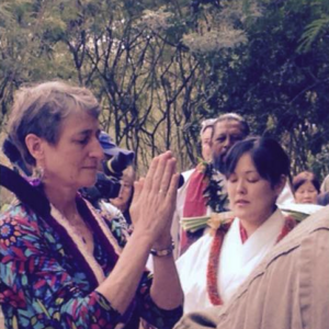 Interior Secretary Sally Jewell (left) takes part in the blessing ceremony.