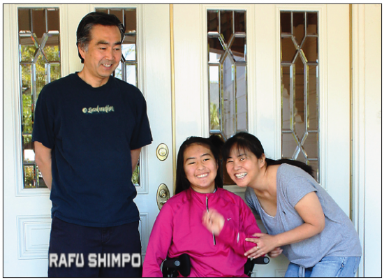 Kelli Sakaguchi is joined by her parents Naomi and Wesley at their home in Torrance. Get Up 8 Foundation will raise money to help in her future medical care at the third annual Jamie Pajo Outrigger Race on May 2. (GWEN MURANAKA/Rafu Shimpo)