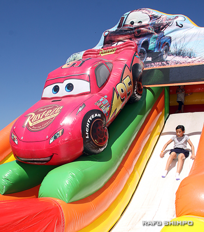 Lightning McQueen had to make room for some kid contenders on a giant slide, one of the many activities for young visitors.