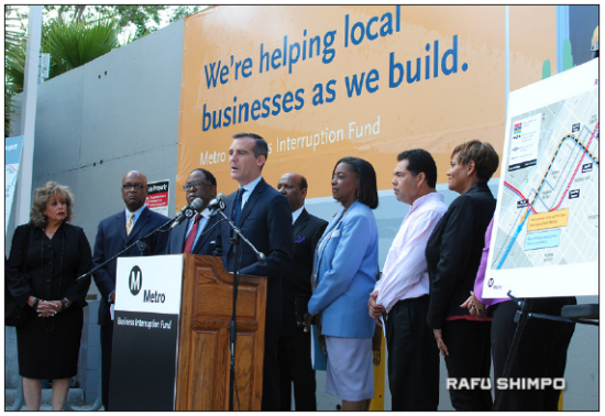 CAP: Mayor Eric Garcetti, flanked by small business owners, introduces the Business Interruption Fund for businesses impacted by construction of the rail transit systems, including the Regional Connector. (RYOKO NAKAMURA/Rafu Shimpo)