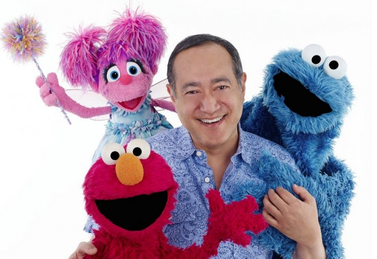 "Alan Muraoka with some of his ""Sesame Street"" friends."