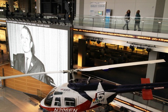 A TV station's helicopter and a big-screen display monitor.