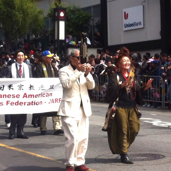 Mark Izu and Brenda Wong Aoki marching for Suite J-Town in the Cherry Blossom Festival Grand Parade on Sunday with Suite J-Town community partner JARF (Japanese American Religious Federation).