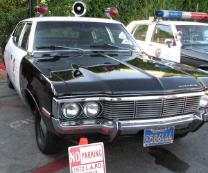 "Vintage patrol cars on display included one from the 1970s TV show ""Adam 12."""