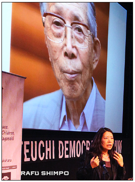 Dr. Akiko Mikamo with a photo of her father, a Hiroshima survivor.