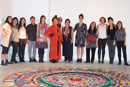 The staff and artists of Suite J-Town, a First Voice production. From left: Charlene Kelley, Yuki Maruyama, Elena Nielsen, Junho Kim, Marissa Bergmann, Brenda Wong Aoki, Mark Izu, Jill Shiraki, Rebeka Rodriguez, mandala artist Nancy Hom, Celi Tamayo-Lee, Eryn Kimura, Nicole Hsiang. Not pictured is Kevin King, Prayer Pagoda artist.