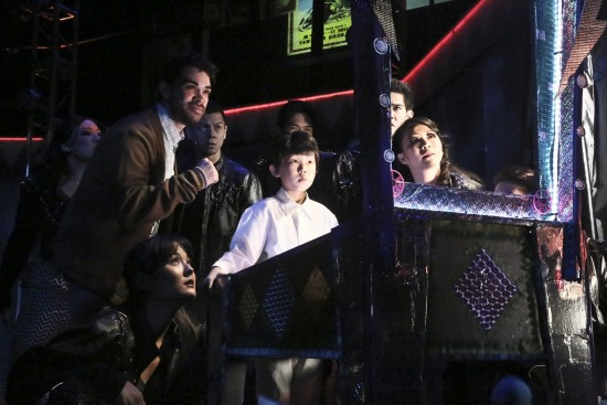 """Ten-year old Tommy (Michayla Brown) shows off his pinball skills in the East West Players production of """"The Who's Tommy."""" Also pictured (from left): Ensemble members Tina Nguyen, Ryan Castellino, Cailan Rose, Marius Beltran, Cesar Cipriano, Michael Dashefsy, Christine de Chavez. (Photo by Michael Lamont)"""