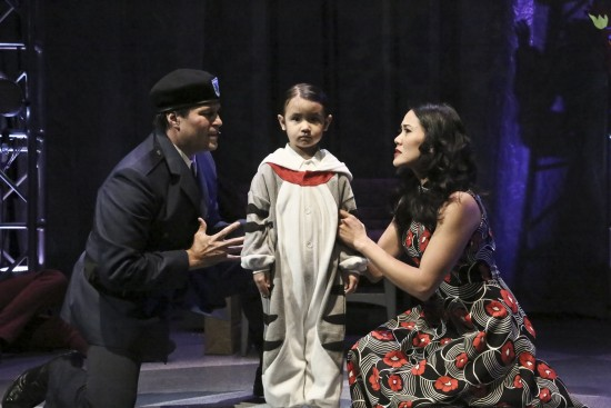"Capt. Walker (Cliffton Hall) and Mrs. Walker (Deedee Magno Hall) try to convince 4-year-old Tommy (Araceli Prasarttongosoth) that he did not see or hear the murder that just took place in the East West Players production of ""The Who's Tommy.""  (Photo by Michael Lamont)"