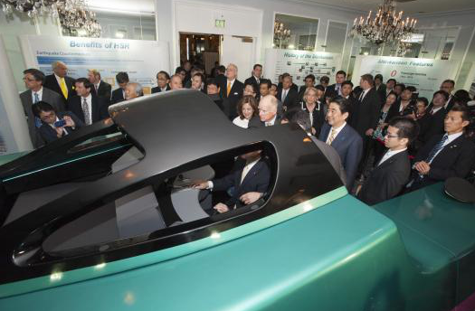 Gov. Jerry Brown, First Lady Anne Gust Brown and Prime Minister Shinzo Abe view a high-speed rail simulator.