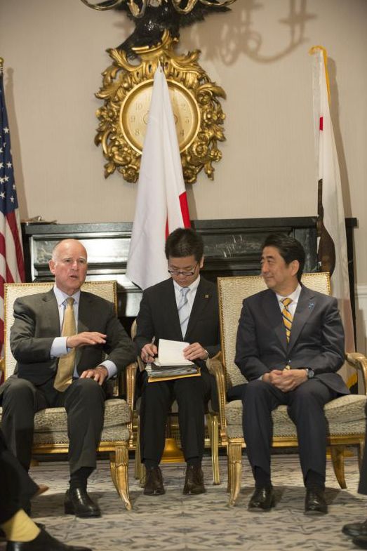 Gov. Jerry Brown and Prime Minister Shinzo Abe talk with the help of an interpreter.