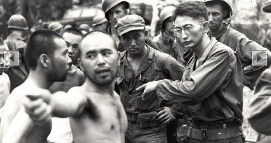 Harry Fukuhara (wearing glasses) interrogates a Japanese POW in New Guinea in 1944.