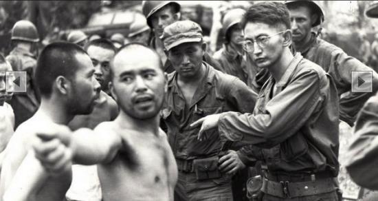 Harry Fukuhara (wearing glasses) interrogates a Japanese POW in New Guinea in 1944.