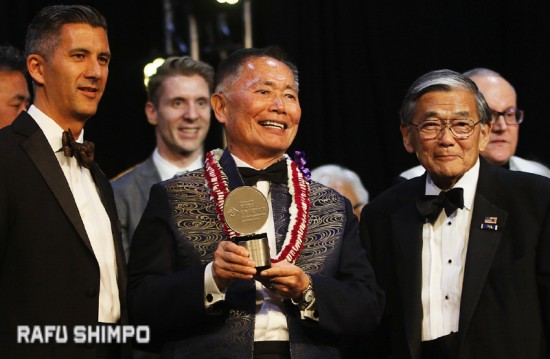 George Takei receives a distinguished medal of honor for lifetime achievements at the Japanese American National Museum gala on May 2. He is joined by Dr. Greg Kimura and Norman Mineta, who is the new chair of the JANM board of trustees.