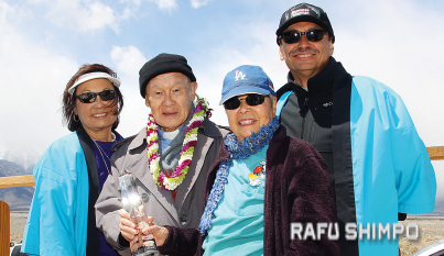 Rev. Paul Nakamura, second from left, accepts the Sue Kunitomi Embrey Legaacy Award. With him are Kerry Kunitomi Cababa, Rev. Nakamura's wife Kikuno, and Bruce Kunitomi Embrey.