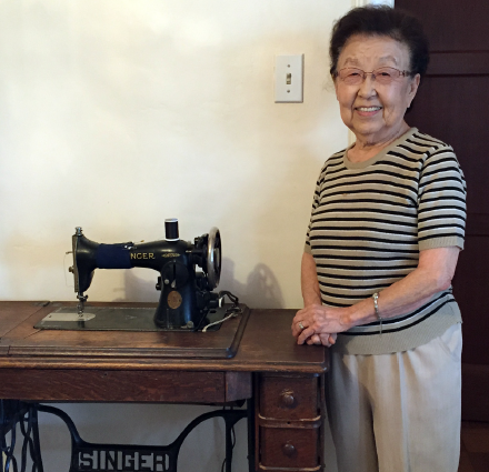 Shinoda and her Singer sewing machine.