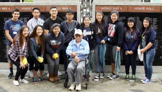 Jim Yamashita (center), a 442nd veteran, joins students and veterans at the Spit & Polish clean-up of the Japanese American National War Memorial Court in Little Tokyo on May 9.