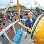 Steve Minoda keeps time on the taiko for the scores of dancers who took the overcast and muggy conditions in stride.