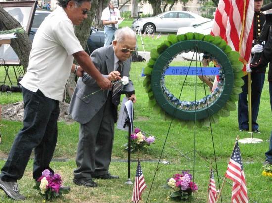 Masao Masuda, brother of Staff Sgt. Kazuo Masuda, made a floral presentation.