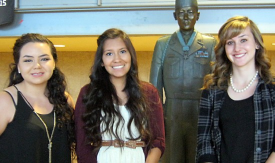 "Scholarship recipients Alexandria Monjoy, Jennifer Begay and Kelly Radcliff with statue of Hiroshi ""Hershey"" Miyamura in Gallup, N.M."