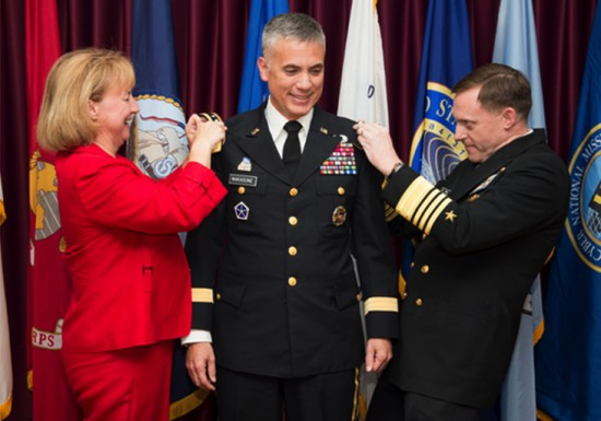 Susan Nakasone and Adm. Michael Rogers pinning the second star on Maj. Gen. Paul Nakasone.