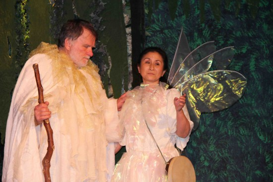 Prospero (Andy Kallok) and Ariel (Randi Tahara) as Ariel tells Prospero that the King and his men, which have been enchanted, are suffering under Prospero's spell.