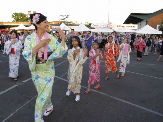 Kids follow Shuko Akune, one of the lead dancers, at a previous SFVBT Obon Festival. (J.K. YAMAMOTO/Rafu Shimpo)