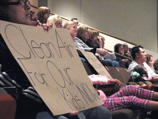 Students from Oak View Elementary School and their parents held up signs during a Huntington Beach City Council meeting in 2013. (J.K. YAMAMOTO/Rafu Shimpo)