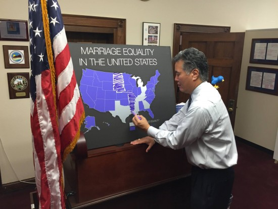 After the Supreme Court's decision in Obergefell v. Hodges, Rep. Mark Takano (D-Riverside), the first openly gay person of color in Congress, fills in a map that showed which states support marriage equality.