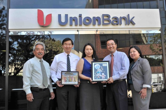 From left: Brian Kito, Little Tokyo Public Safety Association president; Paul Abe, Union Bank vice president and branch manager, Union Bank; Masumi Muya, Los Angeles Tanabata Festival 2015 chair; George Tanaka, Union Bank managing director and head of retail specialized markets; Nancy Okubo, Union Bank vice president and market sales and support specialist. Muya presented a plaque to Union Bank for its corporate sponsorship of the festival.