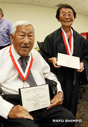 The Kaiharas with their diplomas.