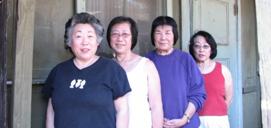 From left: Cindy Yuge, Joyce Yuge, Carolyn Yuge and Nadine Ishizu in front of living quarters for agricultural trainees from Japan that their father hosted.