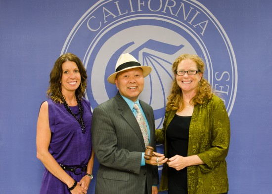 Foundation for California Community Colleges CEO Keetha Mills and past chair Patricia Sullivan hand the gavel to new chair Lance Izumi.