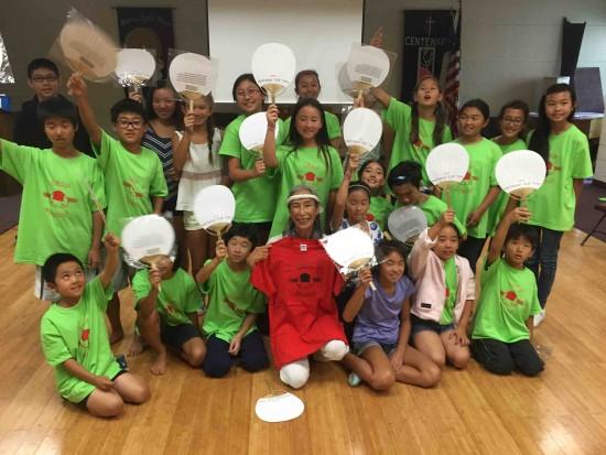"""Nobuko Miyamoto at a """"Sembazuru"""" workshop with Camp Musubi kids."""